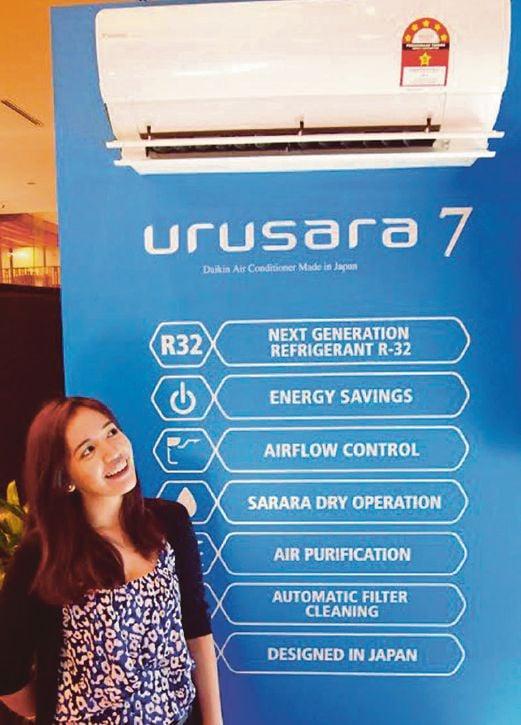 PR executive Carmelia Emuang enjoying the cool, purified air breeze coming from Daikin Urusara 7 air-conditioner.