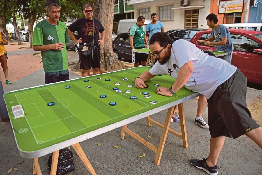 Buttons Fly In Brazilian Tabletop Football Game New Straits Times