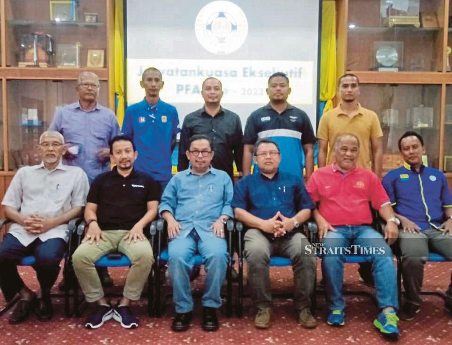 Perlis FA president Zamri Ibrahim (front third from left) with the newly elected committee members yesterday. PIC BY DZIYAUL AFNAN ABDUL RAHMAN