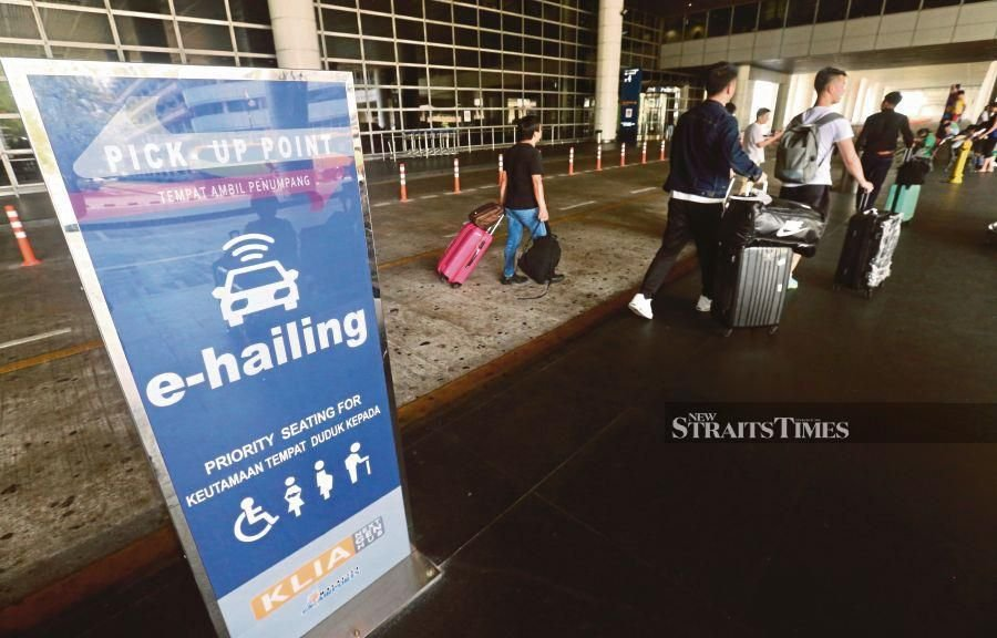 The new designated pick-up points for e-hailing services at the Kuala Lumpur International Airport in Sepang are now at Doors 3 and 4, Level 1 of the Main Terminal Building. PIC BY INTAN NUR ELLIANA ZAKARIA