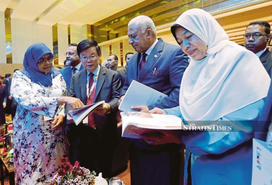 Fiji's Prime Minister Josaia Voreqe Bainimarama (second from right) looking at 'The Future of Asian and Pacific Cities' report at the Seventh Asia-Pacific Urban Forum in Bayan Baru in October. With him are Penang Chief Minister Chow Kon Yeow (second from left) and Housing and Local Government Minister Zuraida Kamaruddin (right). The report makes a case for the link between achieving sustainable development goals and the 'New Urban Agenda'. FILE PIC