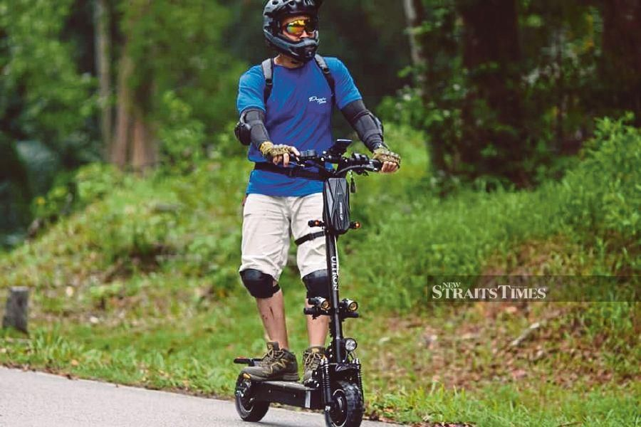 E-scooter enthusiast Mohd Ezral Jusoph puts on safety gear whenever he rides the e-scooter. - Pic courtesy of Mohd Ezral Jusoph