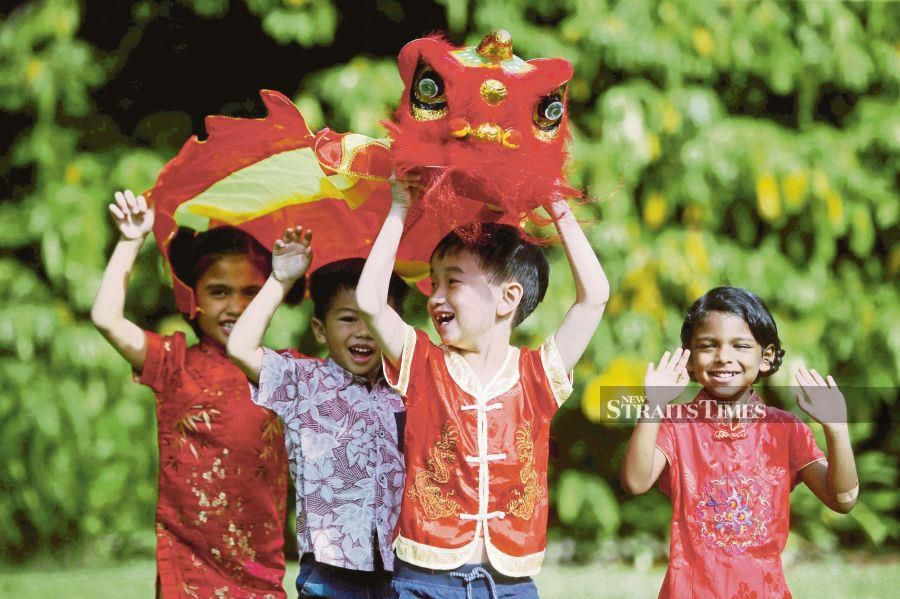 Children of various races taking part in a lion dance during the Chinese New Year in Kuala Lumpur last year. FILE PIC