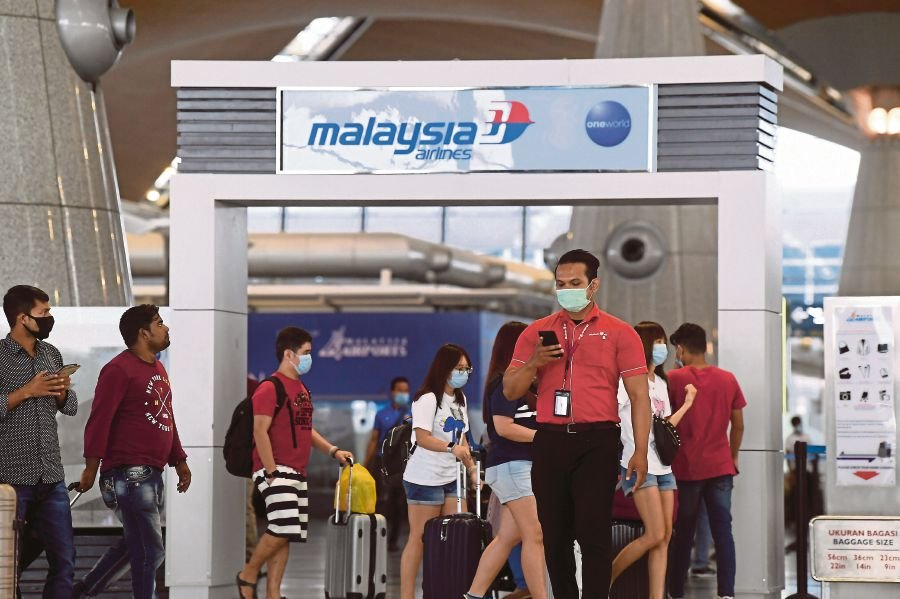 People wearing face masks at Kuala Lumpur International Airport in Sepang yesterday. -BERNAMA pic