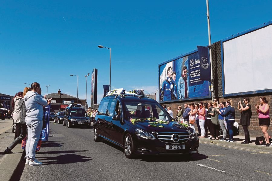 A hearse carrying the coffin of British toddler Alfie Evans drives past Everton's Goodison park stadium in Liverpool. AFP
