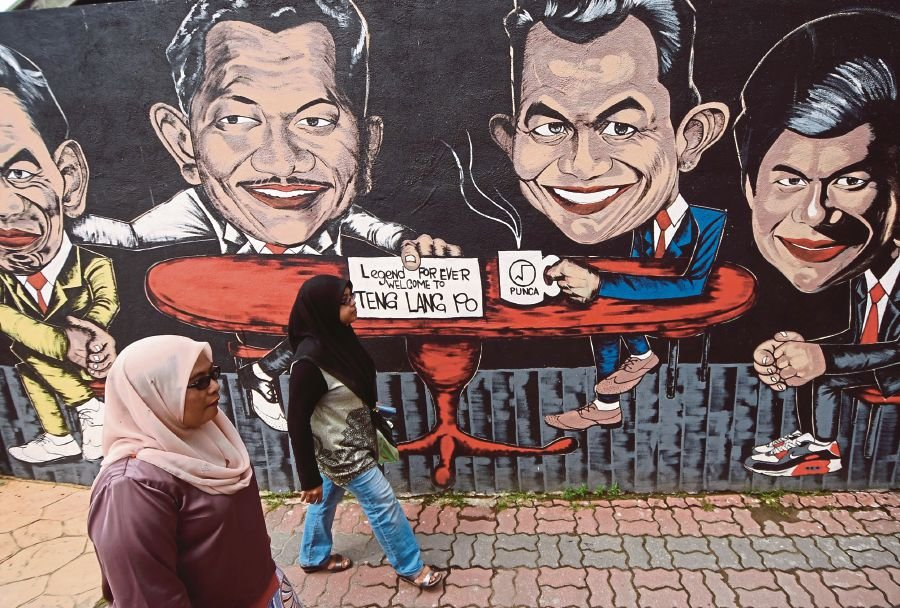 The recent move by nearly a dozen companies and the Terengganu Chinese Chamber of Commerce to paint murals and caricatures on landmark buildings brought some cheer as the effort had visually enhanced the otherwise plain white and grey buildings in the city. FILE PIC