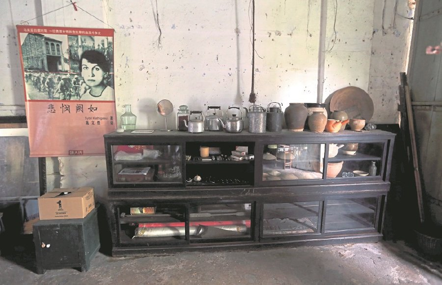 The display cabinet at the shophouse where Sybil Kathigasu once stayed has medical tools that are unique to that era.