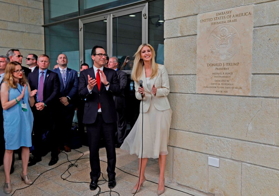 US Treasury Secretary Steve Mnuchin (left) and US President's daughter Ivanka Trump stand next to an inauguration plaque during the opening of the US embassy in Jerusalem. AFP