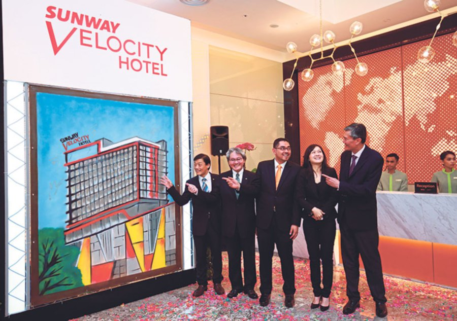 (From left) Sunway Hotels & Resorts cluster director of operations Kelly Leong, Sunway Hotels and Resorts chief executive officer (CEO) Albert Cheong, Fawanis Sdn Bhd director Ahmad Zulkarnain, Sunway Group property division managing director for Malaysia and Singapore Sarena Cheah and Sunway REIT CEO Datuk Jeffery Ng at the unveiling of Sunway Velocity Hotel.