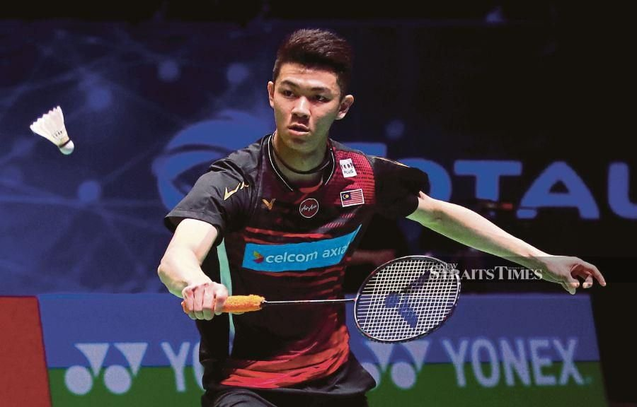 Lee Zii Jia plays a return to Viktor Axelsen during their All England semi-final match on Saturday. -AFP pic