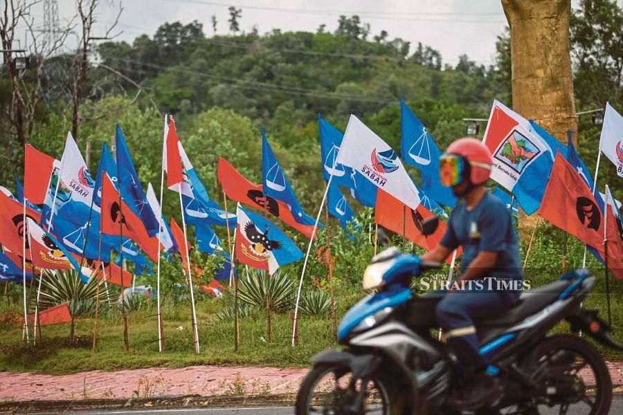 Myriad party flags put up along Jalan Bandar Siera in Kota Kinabalu in conjunction with the 16th Sabah Election.  PIC BY ASWADI ALIAS