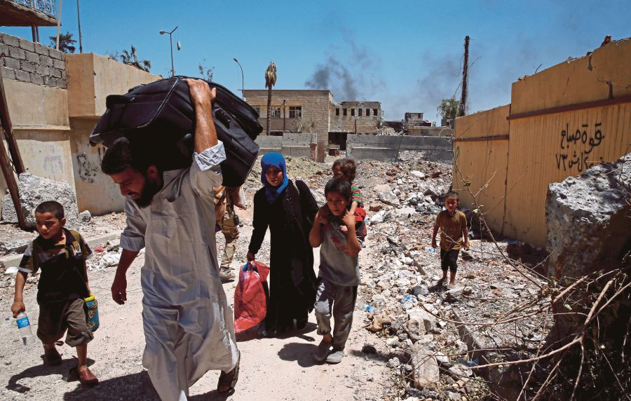 Displaced Iraqi residents fleeing their homes due to fighting between Iraqi forces and Islamic State militants near the Old City in western Mosul, Iraq. IS fighters have twisted the concept of spiritual rewards for their own corrupted beliefs. They believe that they will receive more rewards from God should they unleash terror during Ramadan. FILE PIC