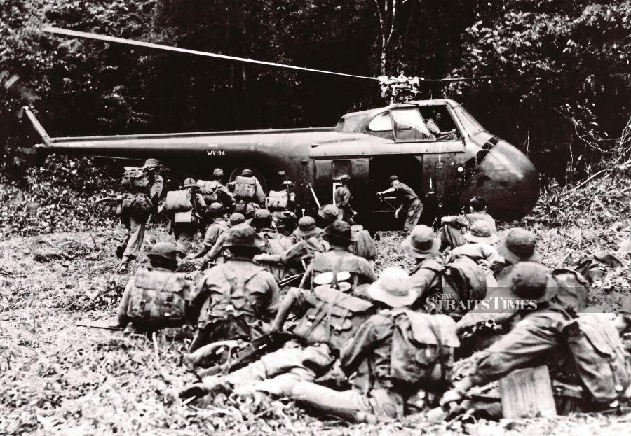 During the Emergency, Malayan forces and police combined with Commonwealth troops to battle the communist terrorists. PIC FROM NSTP ARCHIVE