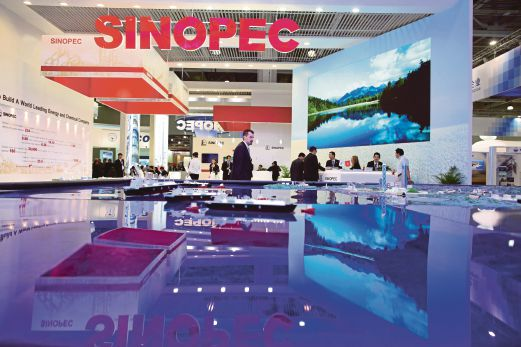 A logo sits on display at the Sinopec pavilion during the 21st World Petroleum Congress in Moscow in June. China has been actively acquiring foreign assets, particularly energy and resources, to power its economy. Bloomberg pic