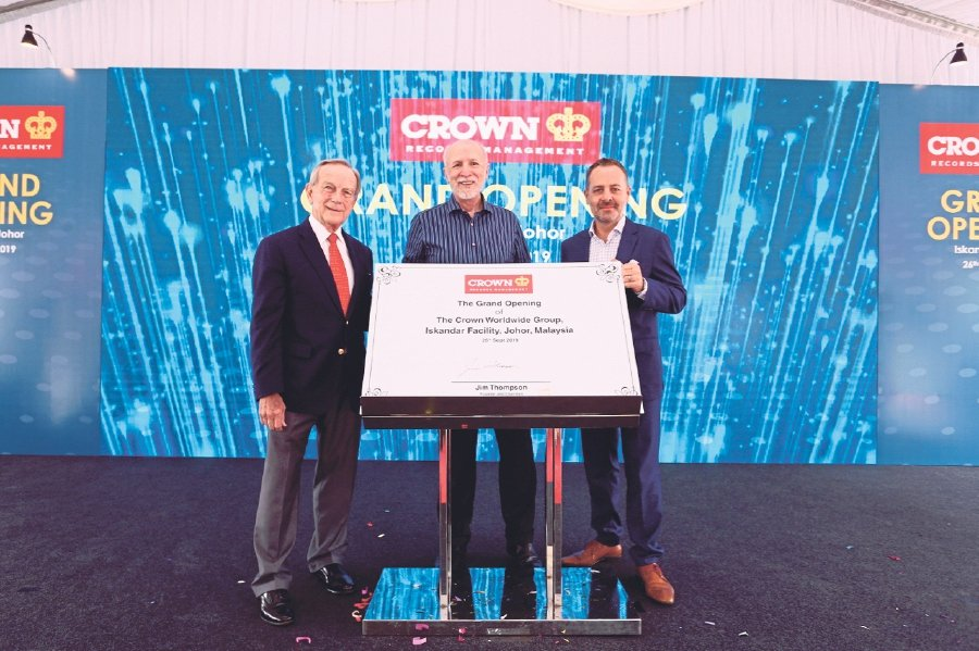 (From left) Crown Worldwide Group founder and chairman James E. Thompson, Crown Worldwide Group chief executive officer Ken Madrid and Crown Worldwide Group Sdn Bhd managing director for Malaysia Leon Hulme launching the new Crown Records Management facility.
