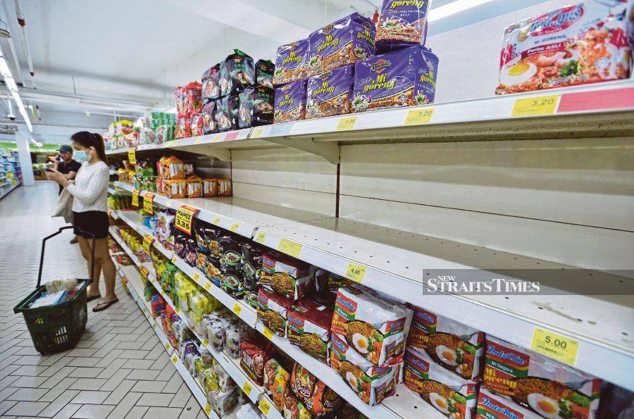 Instant noodles have been snapped up by shoppers at Giant Amcorp Mall in Petaling Jaya. -NSTP/ASWADI ALIAS