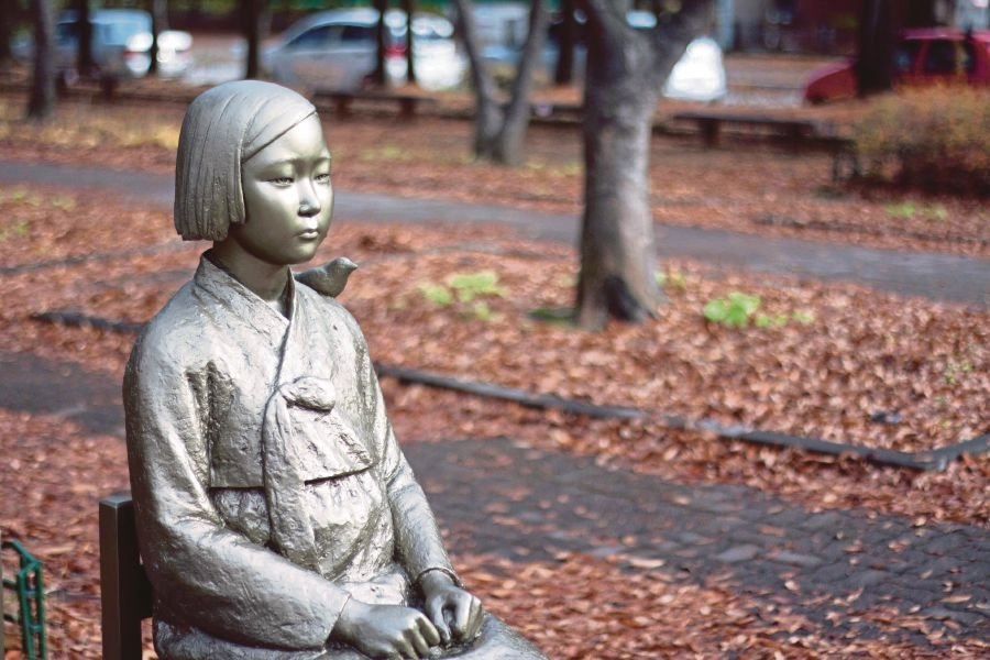 Statues dedicated to comfort women have been erected in South Korea and other countries. During World War 2, comfort women had to hand over most of their earnings to the brothel's manager, but had to use their own money for clothing, hair care and cosmetics, resulting in many girls being heavily indebted.