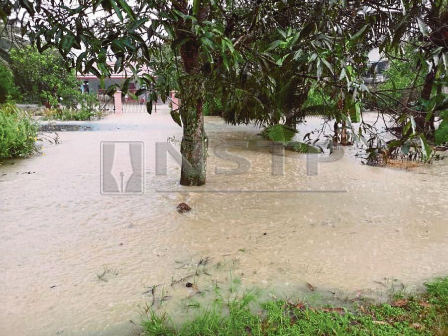 Water overflowing from the drain in Kampung Seri Air Hitam on a rainy day. FILE PIC