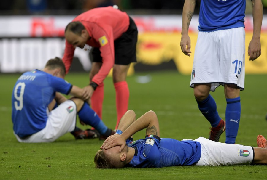 Italian footballers reacts at the end of the FIFA World Cup 2018 qualification football against Sweden, on November 13, at the San Siro stadium in Milan. Italy failed to reach the World Cup for the first time since 1958 on Monday as they were held to a 0-0 draw in the second leg of their play-off at the San Siro by Sweden, who qualified with a 1-0 aggregate victory. AFP