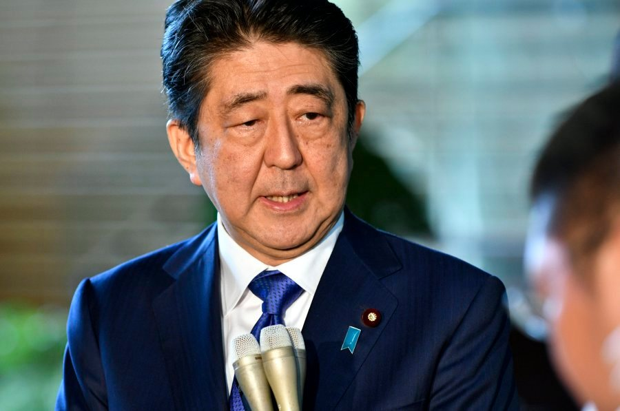 Japanese PM Shinzo Abe plans snap election as 'strongman' ratings surge