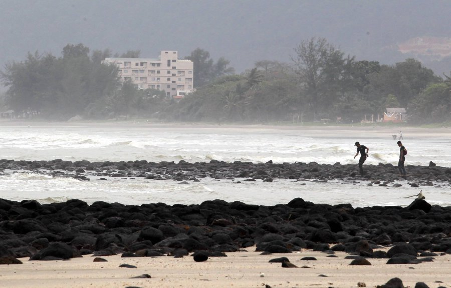 Despite Monsoon Dangers, Young Surfers Swarm Terengganu's Beaches