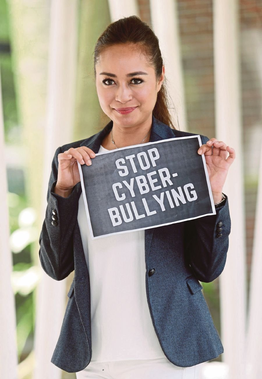 """""""I can't divulge the details of these insults and threats, but they targeted my family in Malaysia and Germany,"""" said Maya at the launch of the End Cyber-Bullying And Spreading False Information campaign at the Kuala Lumpur Performing Arts Centre here, today. (Pix by HALIMATON SAADIAH SULAIMAN)"""