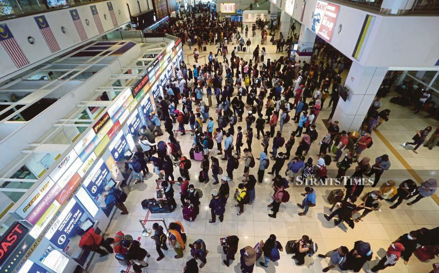 People queuing up to buy tickets at the Southern Integrated Terminal in Kuala Lumpur yesterday. - NSTP/ROHANIS SHUKRI