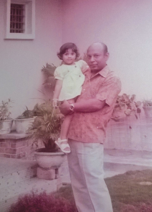 The writer at age 4 with her late father.