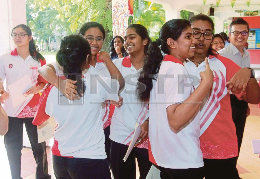 (File pix) Students of SMK Perempuan St George in George Town, Penang rejoicing after receiving their PT3 results. Students should start thinking about their career paths after Form 3. Pix by NSTP/Danial Saad