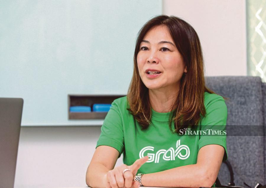 GrabPay managing director Ooi Huey Tyng says the company plans to help an additional five million traditional businesses capitalise on cost-saving benefits. -- Pix: NSTP/ ZULFADHLI ZULKIFLI