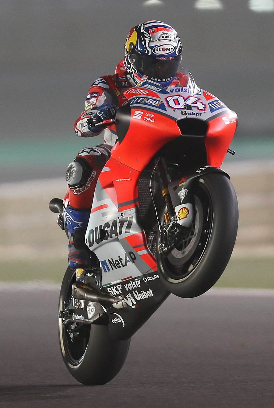 Ducati's Italian driver Andrea Dovizioso competes during the MOTOGP qualifiers at the Losail International Circuit in Doha. AFP