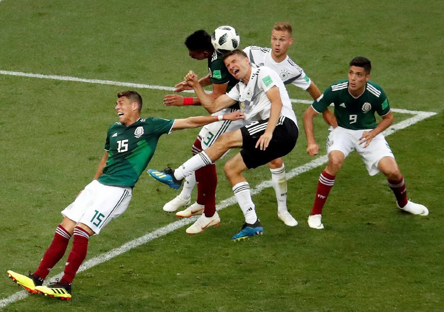 620524a5b Germany s Thomas Muller and Joshua Kimmich in action with Mexico s Hector  Moreno