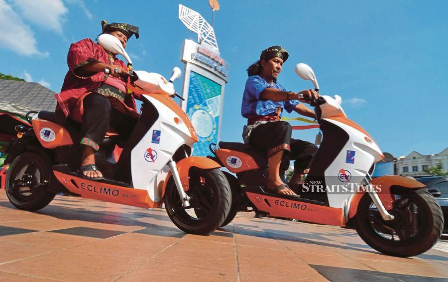 Eclimo electric scooters are spearheading efforts towards enviromentally friendly vehicles. - NSTP file pic