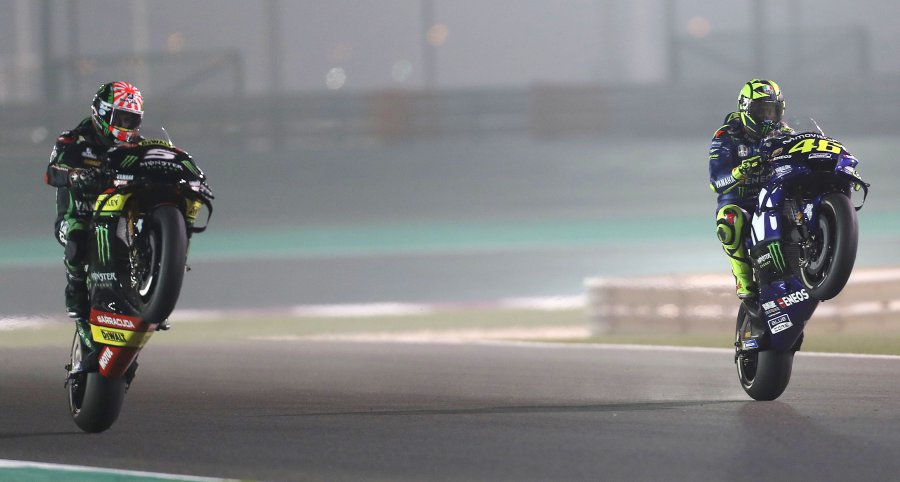 Monster Yamaha Tech3's French driver Johann Zarco (left) and Movistar Yamaha's Italian driver Valentino Rossi (R) in action during the MOTOGP qualifiers at the Losail International Circuit in Doha. AFP