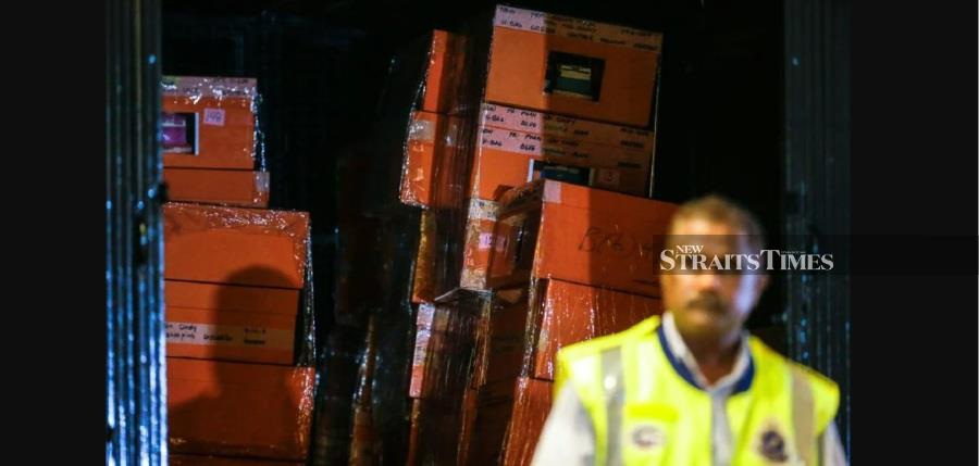 One of the police trucks loaded with boxes seen parked at the lobby of the Pavilion Residents. Pic by LUQMAN HAKIM ZUBIR