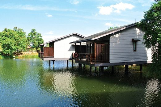 The Jala Villas are perched on a lake.