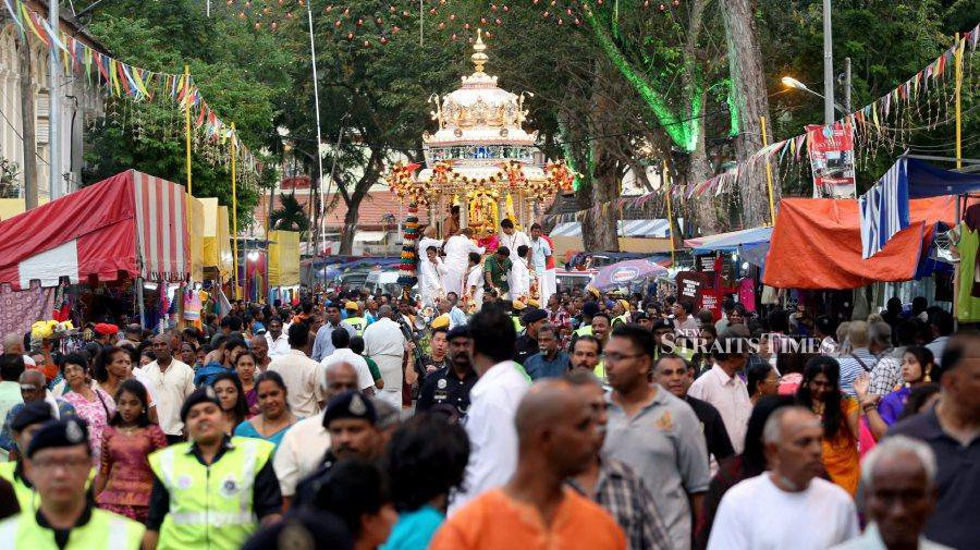 The procession of the over 100-year-old silver chariot and the recent golden chariot is the highlight of the annual three-day Thaipusam celebration in the state. - NSTP/File pic/pic taken before the Covid-19 pandemic.