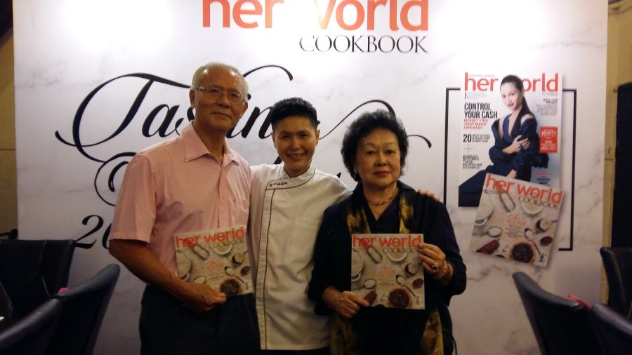 Yenni and her proud parents during the book launch.