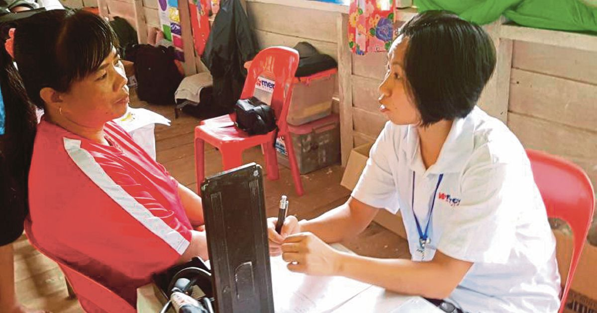 Mobile clinic blessing for villagers