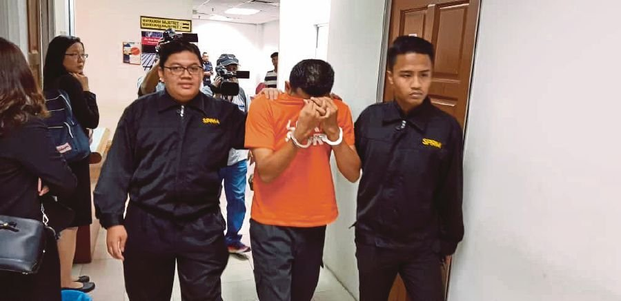 The irony is that some were somehow exempted from wearing the Malaysian Anti-Corruption Commission's orange T-shirt. The question is, why the exemption?. Courtesy of MACC