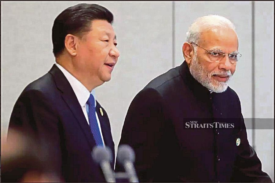 Chinese President Xi Jinping and Indian Prime Minister Narendra Modi at the Shanghai Cooperation Organisation summit recently. - Reuters