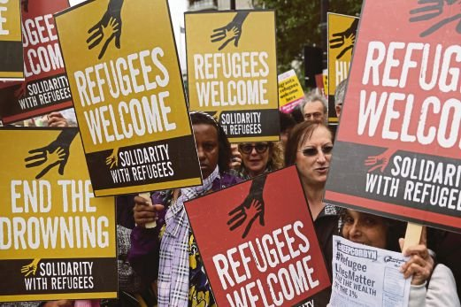 Britons showing support for refugees and migrants in London on Saturday. AFP pic