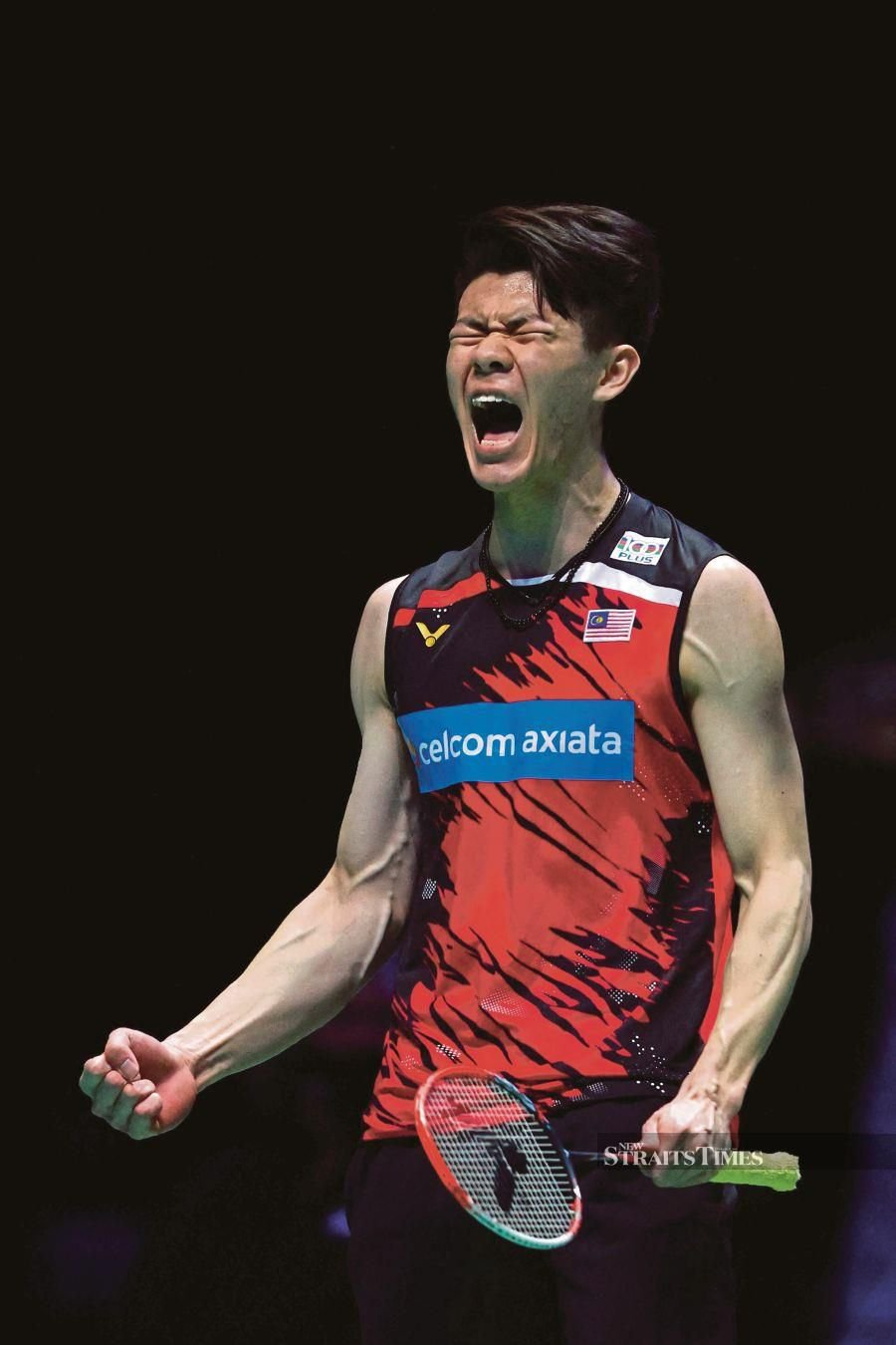 Lee Zii Jia celebrates winning a point after a long rally against Denmark's Viktor Axelsen in the All England final in Birmingham today. AFP pic