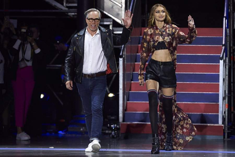 d1d1757f US designer Tommy Hilfiger (L) and US model Gigi Hadid greet the crowd  after the catwalk show for the Spring/Summer 2018 collection on the fifth  and final ...