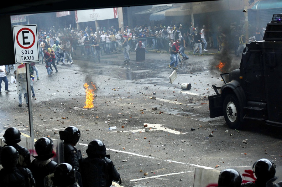 Image result for Boy, woman killed in Venezuela mass protests