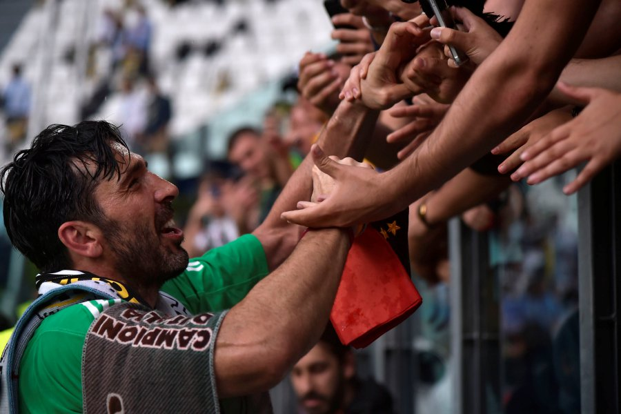 126a590bc22 Juventus' goalkeeper from Italy Gianluigi Buffon greets fans at the end of  the Italian Serie A football match Juventus versus Verona, on May 19, ...