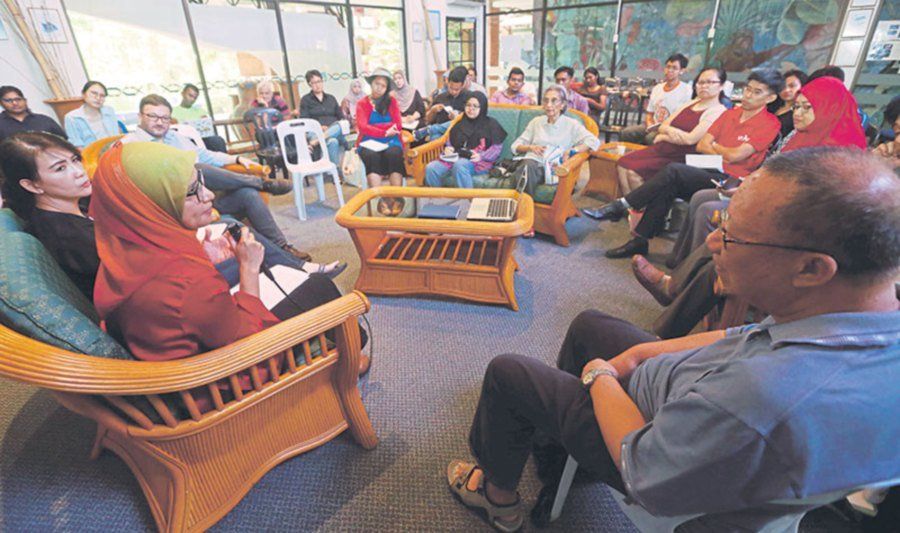 Attendees of the Rimba Project's Conservation Conversation listening to the discussion on nature conservation.