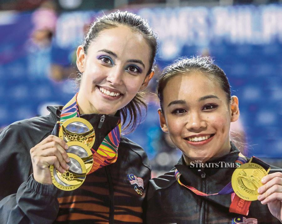Artistic gymnasts Farah Ann Abdul Hadi (left) and Tracie Ang won the gold for their respective events during the recently concluded 30th Sea Games in the Philippines. Malaysia fell short of the desired goal target, although there were surprises in some major events. PIC BY OSMAN ADNAN