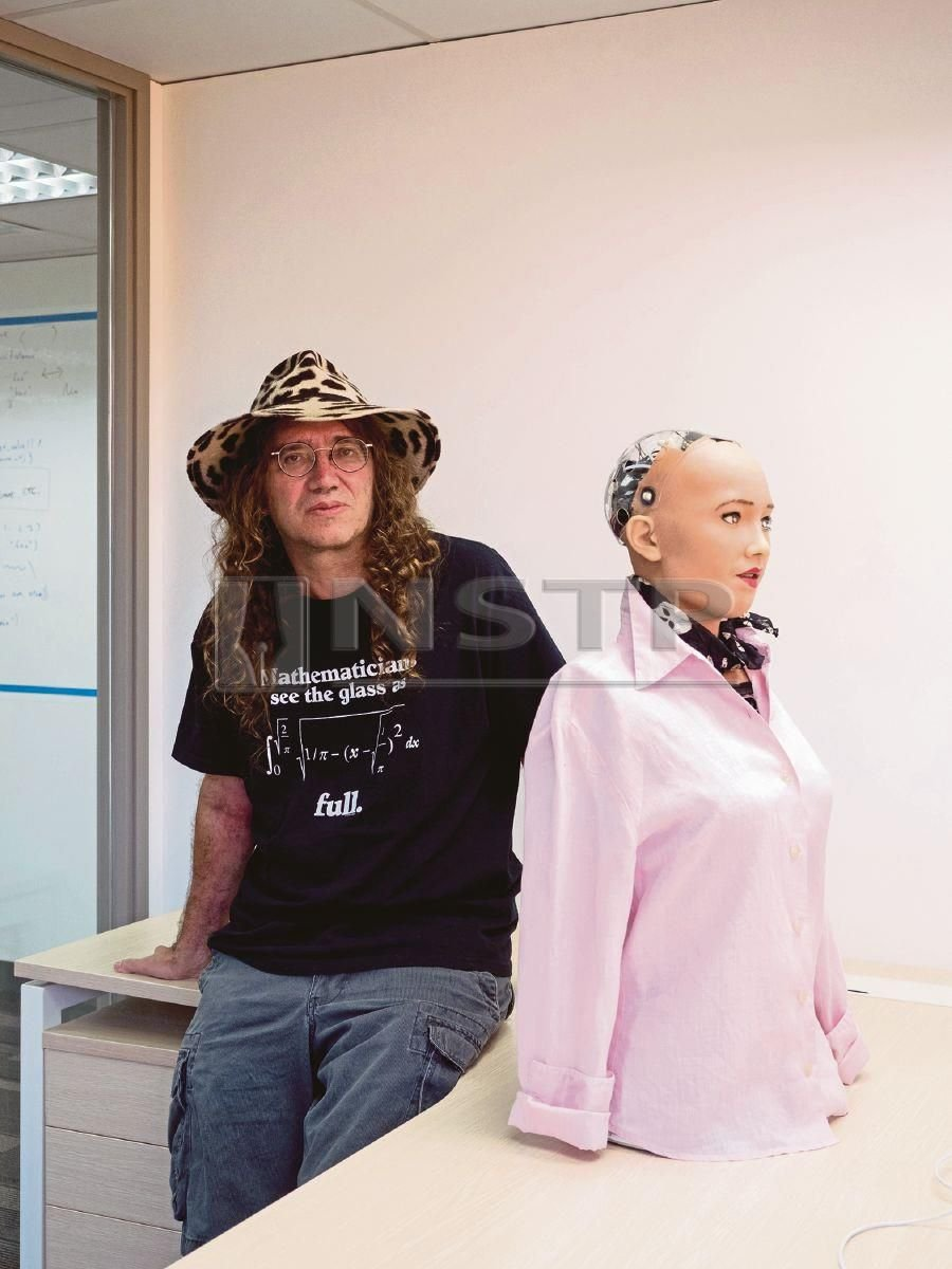 Ben Goertzel, the chief scientist at Hanson Robotics, with the humanoid robot Sophia, an alternative to Amazon's Alexa, in his office in Hong Kong. He wants Sophia to reach out to other AI providers if she cannot find answers to users' questions. NYT PIC