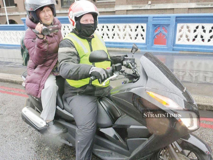 The writer during an assignment to film solo biker Anita Yusof in London. PIX BY ZAHARAH OTHMAN